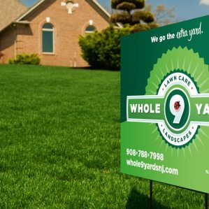 Lawn sign for Whole 9 Yards Lawn Care and Landscaping serving Flemington, New Jersey.